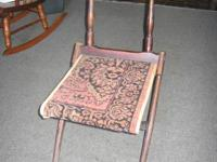 Civil War time Foldable Camp Chair with a Carpet Seat.