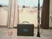 LIKE NEW CLARINET WITH CASE AND NEW REEDS USED VERY