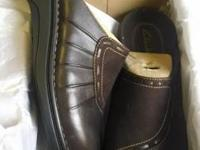 Brown Clark's.  New in box. Size 10.