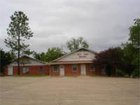 2 nice brick structures offered in Clarksville, Texas.