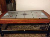 This is a classic hockey table and a mini pool table.