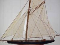 This detailed AMERICA wooden model Sloop stands 3 tall