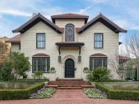 Situated on a beautiful lot on Beverly Drive, the