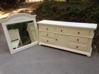 This lovely 9 drawer dresser is and has a matching