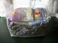 I have a Pooh Crib Set for sale. It is a soft material.