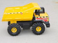 Traditional Tonka Mighty Dump Truck for sale. Rugged