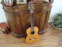 This is a Conn C-20 classical guitar made in the 70's .