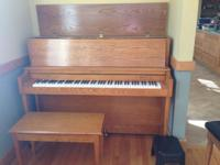 Classic Upright Baldwin Piano with matching stool. This