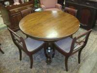 Here we have a beautiful claw foot dining room table.