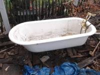 51/2 foot long claw foot iron tub. Complete with brass