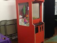 Claw machine is in working condition and has been used
