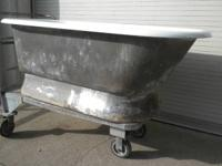 "Antique 60"" clawfoot tub with uncommon pedestal base."