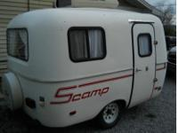 WHAT I HAVE FOR SALE IS A 13 FOOT 2000 SCAMP FIBERGLASS