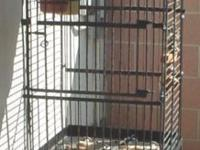 Metal bird cage, utilized, in good condition on