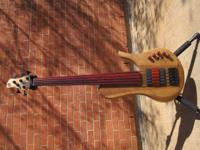 This is a custom fretless Clement Anne 5 string single