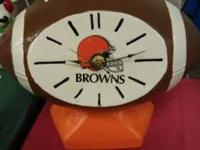 THIS IS A CLEVELAND BROWNS CERAMIC FOOTBALL CLOCK. A