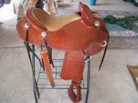 LOOKS NEW...CLINTON ANDERSON SADDLE....LIGHT IN