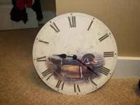 CLOCK WITH A PICTURE OF A WOOD DUCK. JUST NEEDS
