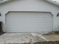 White insulated steel residential garage door 16 foot