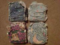 4 Cloth Diapers (need covers) 4 Small Carousel Covers 4
