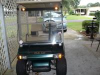 For sale is a 97 Club Car golf cart, green color, runs