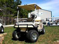 This partial camo cart is loaded. It has the club car