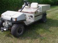 Club car golf cart with dump bed. 10hp kawasaki. It has