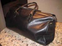 Black leather COACH bag and key fob. Great condition.