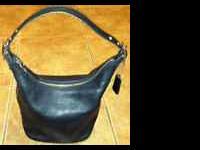 I am selling my Coach handbag It is in great