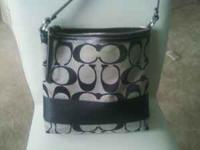 Black and grey signature bag. Excellent condition. If