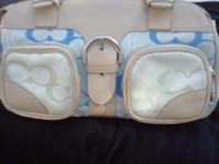 "selling one of my wifes purses. medium size 13"" wide x"