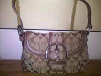 Brand new signature coach purse. Asking 40.00  no