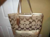 Cute Coach tote - gold/tan - in good condition. $65 -