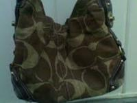 COACH PURSE WITH DUST BAG. TAN AND BROWN COACH COLOR.