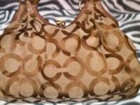 Medium sized coach purse in fair condition. Text :if