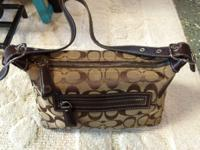 Small Coach purse with Jacquard signature fabric,