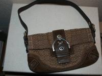 Small brown Coach purse. Utilized for several years,