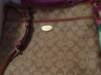 New with tags coach purse in khaki and brown. Asking