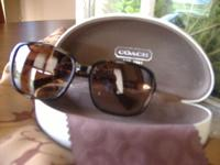 New Coach sunglasses with case in excellent condition.