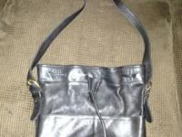 This bag is in good condition, it is not a mini, it is