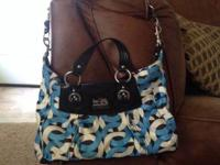 coach handbag is medium sized and in decent condition.
