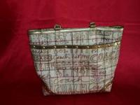 I have a Coach Tote Bag for sale. It is pre owned, but