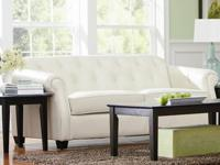 This elegant upholstered stationary sofa will add a