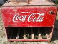 Coca Cola metal cooler cools with block ice.