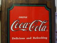 For sale is a wooden Coca-Cola cabinet filled with