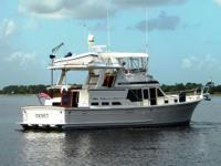 Description This stylish, versatile cockpit motor yacht