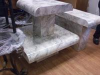 The first picture is a set of marble looking tables. 1