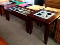 Dark wood and glass leading coffee table with two