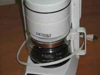 moving sale: 4 cup mr. coffee coffee makers - $5 desk