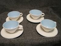 Four (4) nice light blue and white Coffee or Tea Cups